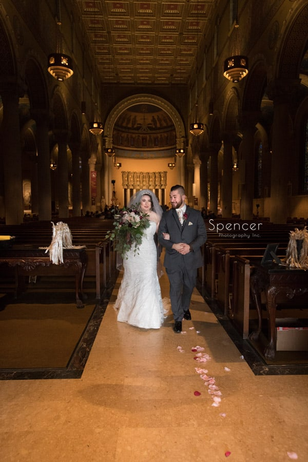 bride and groom recessional at St Joseph Roman Catholic Church