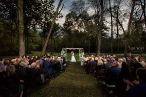 first kiss at outdoor wedding ceremony