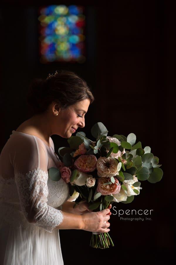 bride smelling her farah nour floral design bouquet