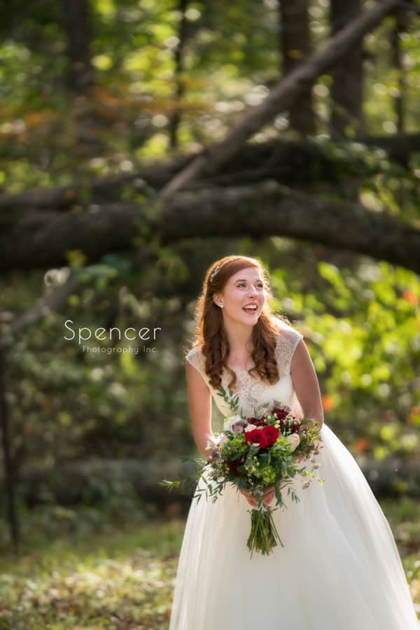 bride smiling before her outdoor wedding ceremony