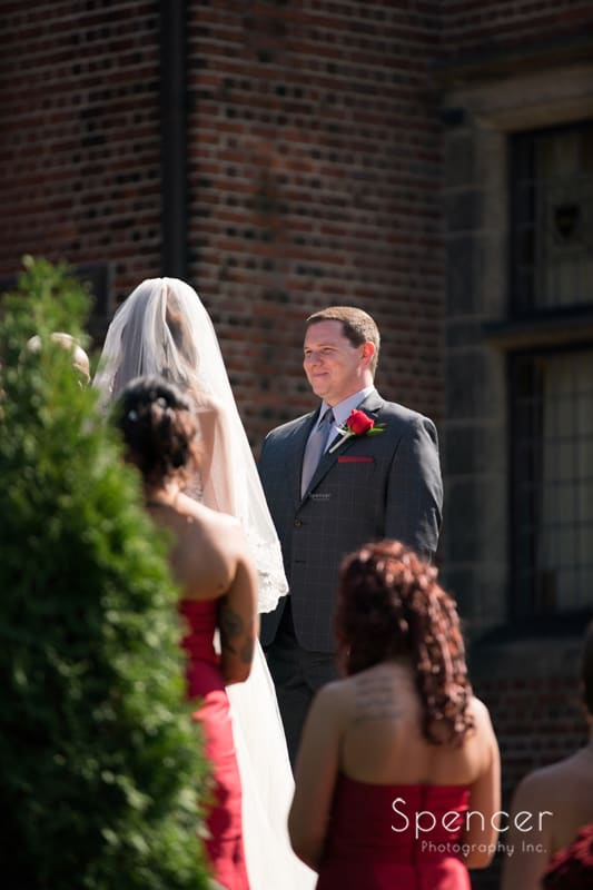groom looking at bride at wedding ceremony at stan hywet