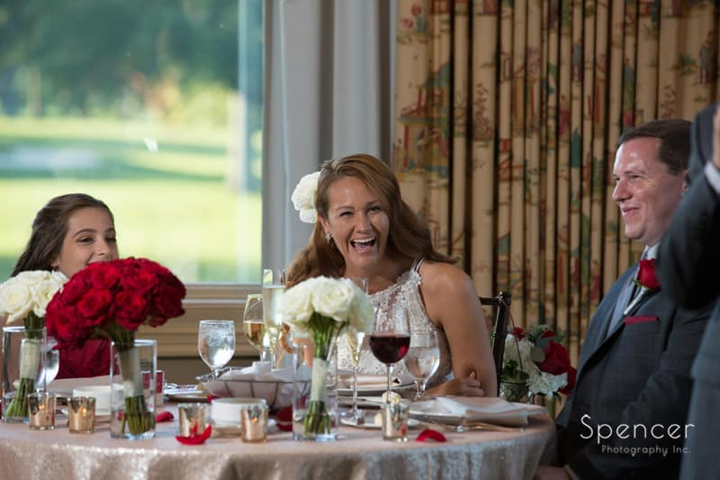 bride laughing at her reception at portage country club