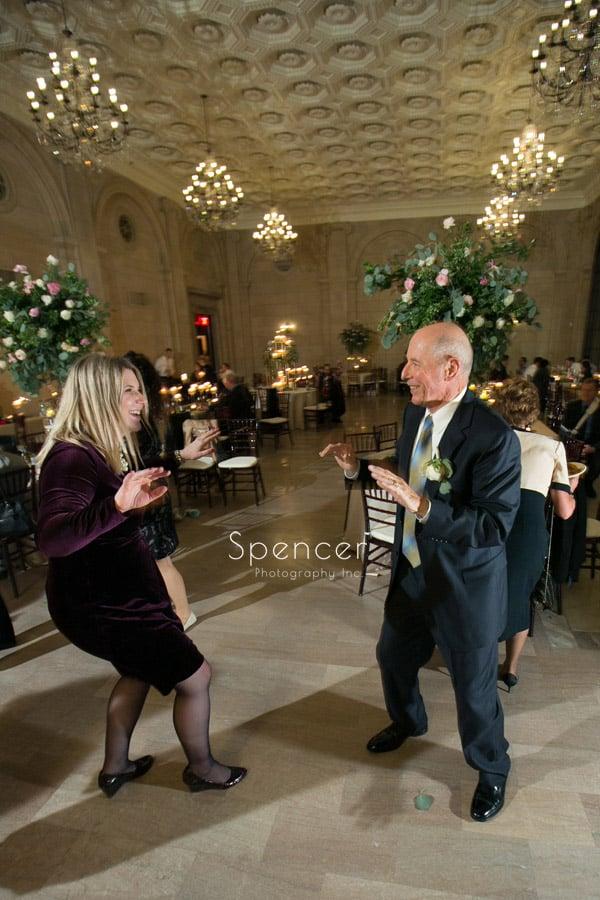 wedding guests dancing at reception at ariel pearl