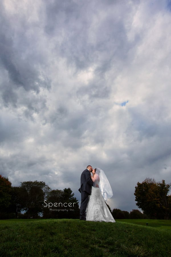 bride groom kissing after wedding in Canton