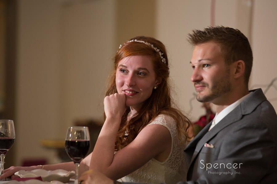 bride listening to reception speech