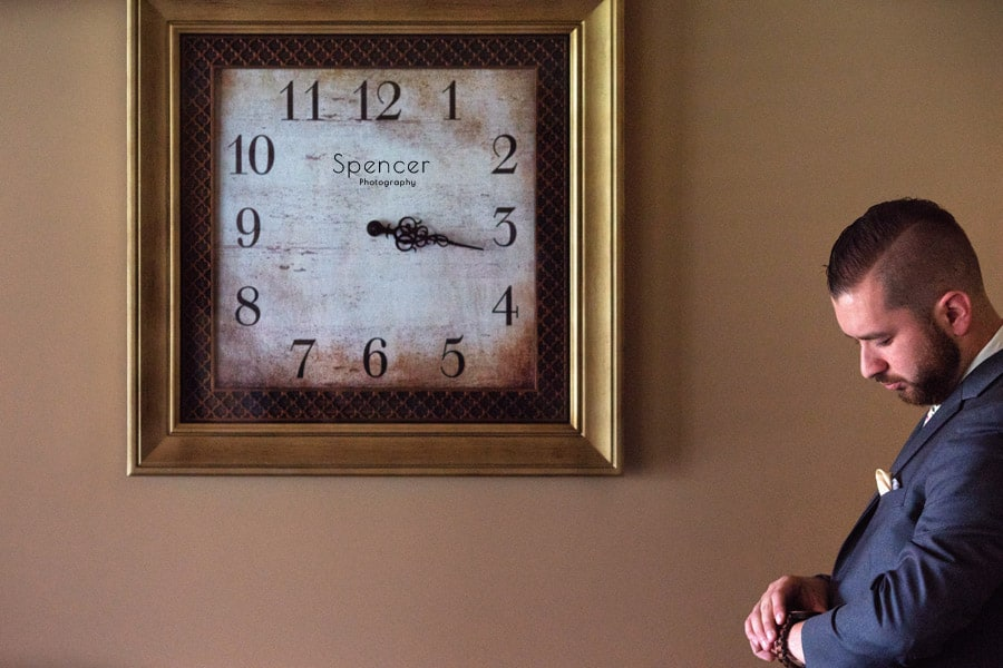 groom checking watch at shady hollow country club