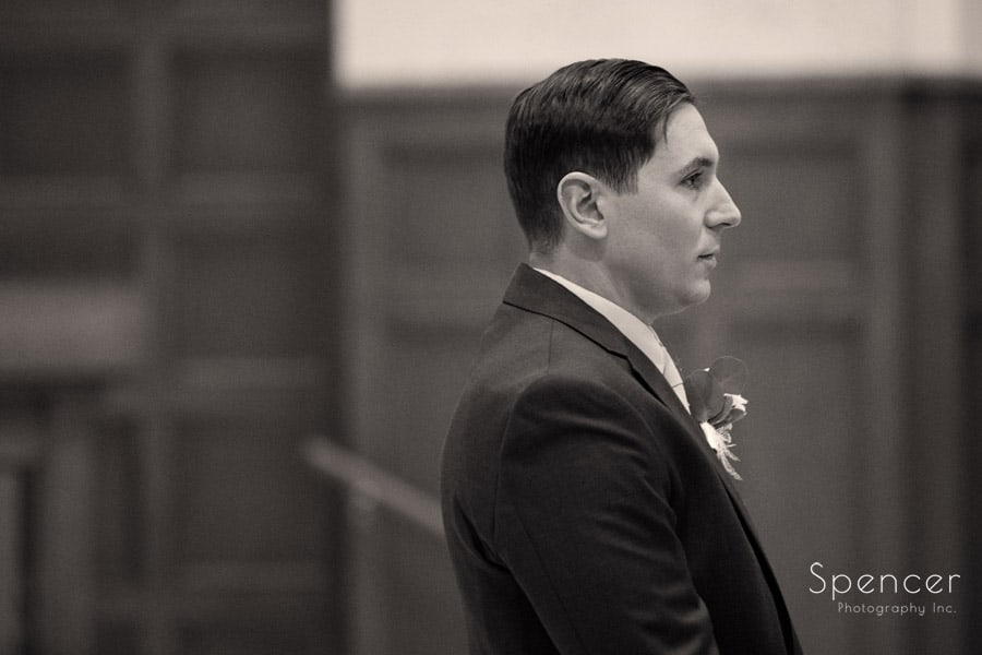 groom watching bride walk down aisle at st christopher cleveland