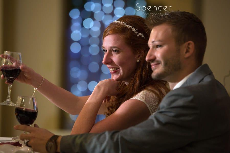bride toasting at wedding reception