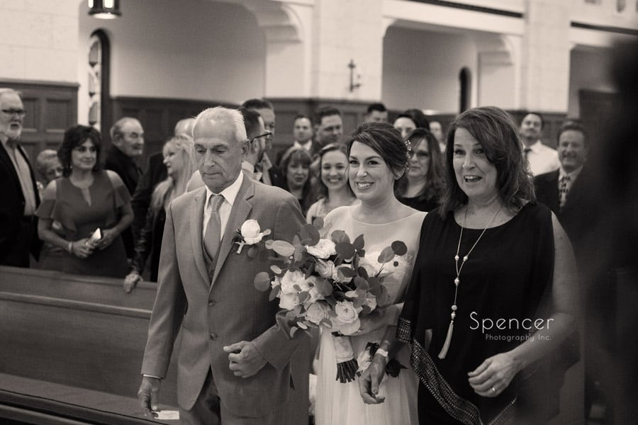 parents walking bride down aisle during wedding at st christopher