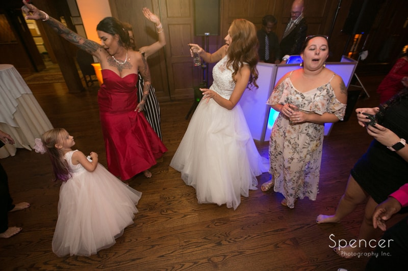 bride partying at her wedding reception at portage country club