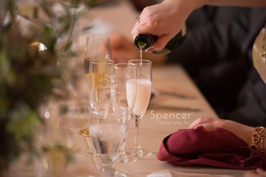 bride pouring champagne at shady hollow country club