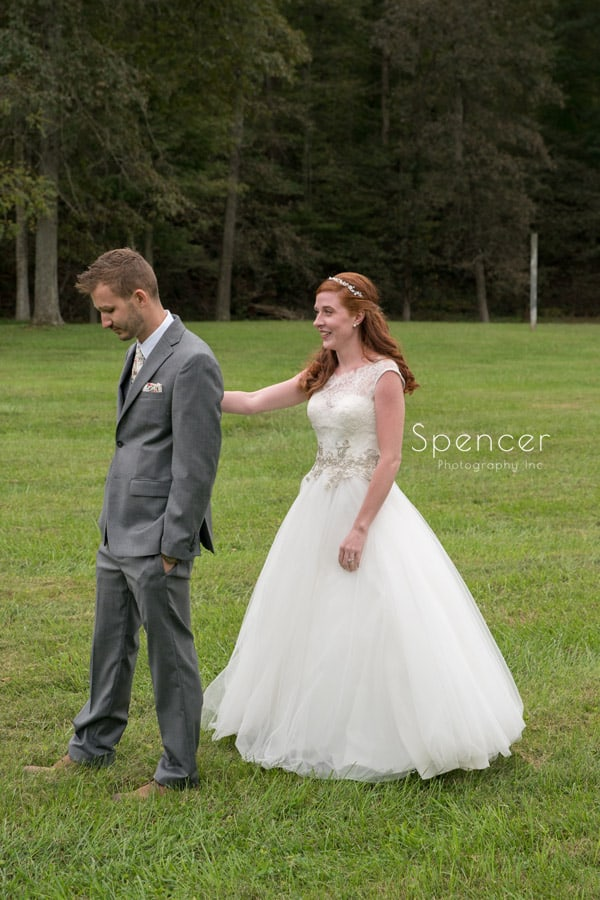 bride touching groom