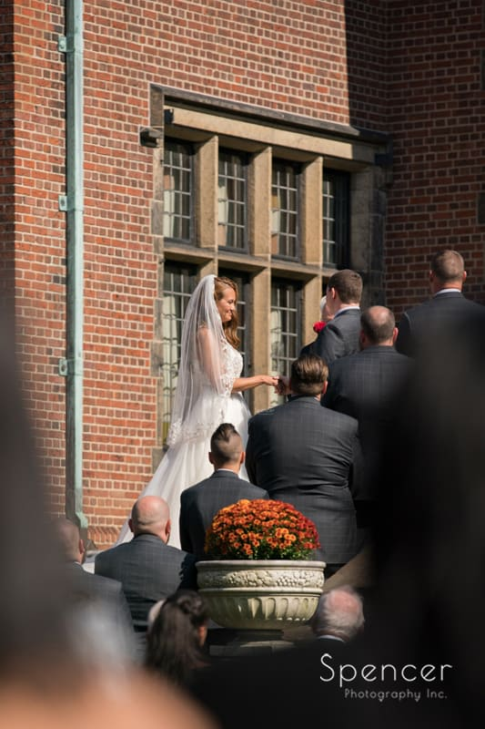 bride looking at groom at wedding ceremony stan hywet