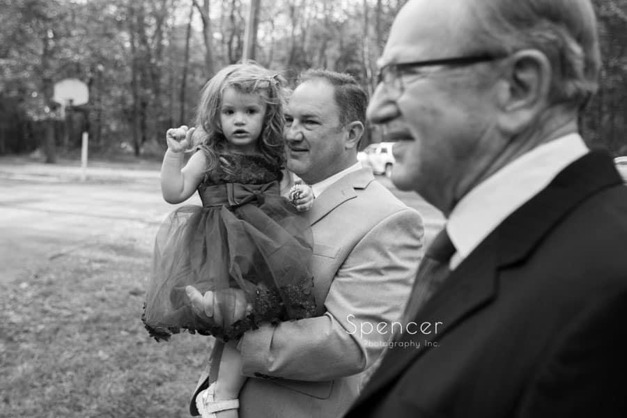 dad holding flower girl