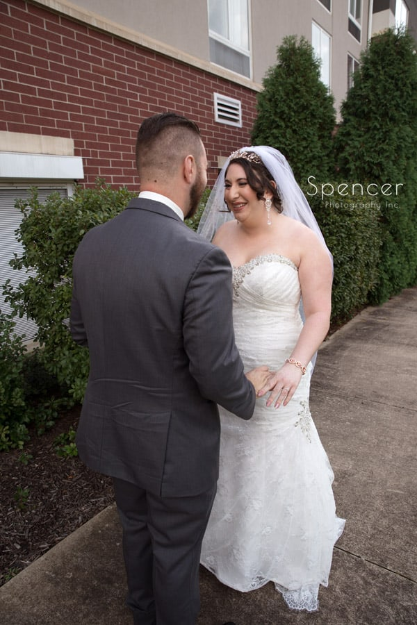 bride and groom holding hands before Canton wedding