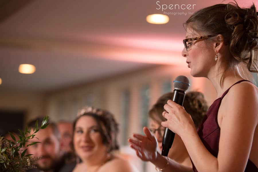 bridesmaid giving reception speech at shady hollow country club