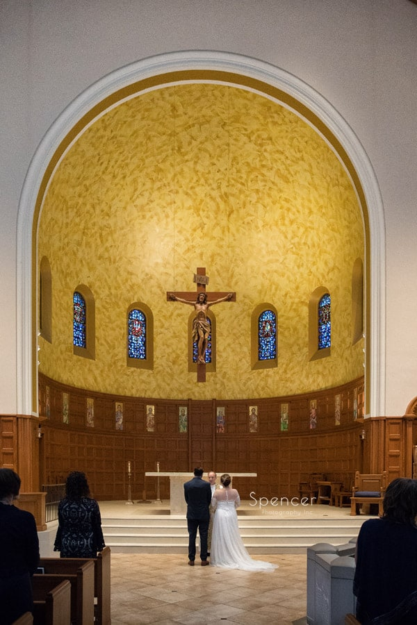 bride and groom at altar of st christopher in cleveland