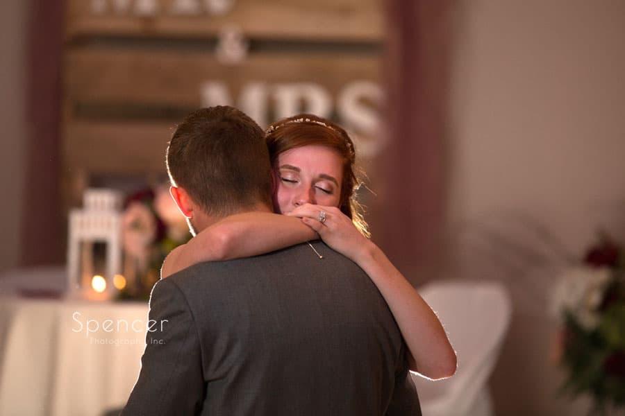 bride hugging groom during first dance