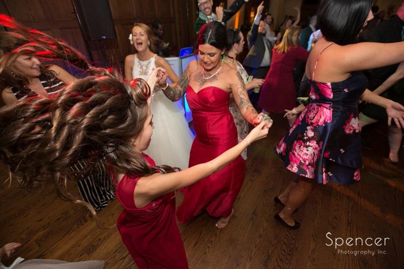 bridesmaids dancing at portage country club wedding reception