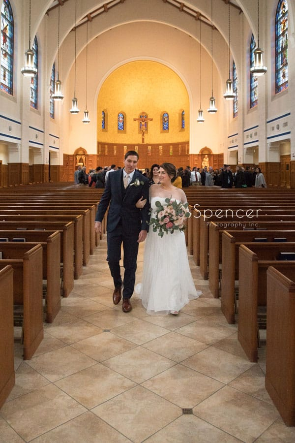 bride and groom exiting their cleveland wedding