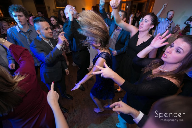 girl flings hair while dancing at portage country club wedding reception