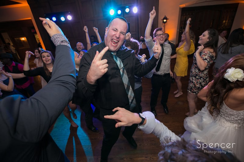 wedding guest hamming to the camera at portage country club