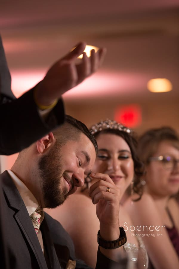groom reacting to best man speech at shady hollow country club reception