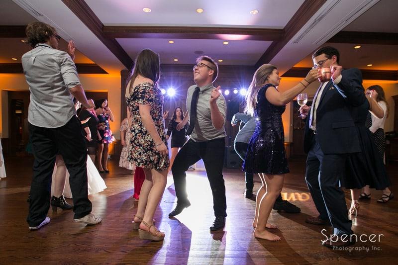 man dancing at wedding reception at portage country club