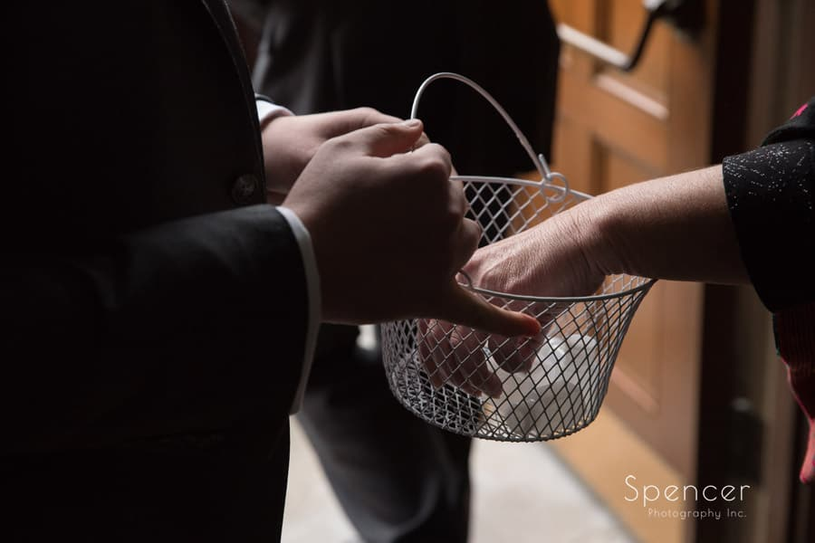 woman taking bubble for wedding send off