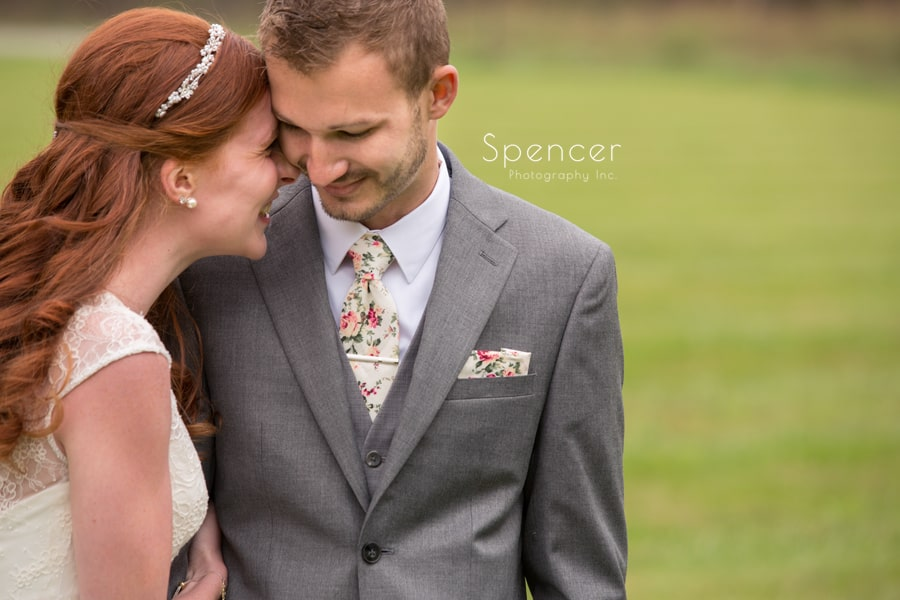 bride and groom snuggle on wedding day