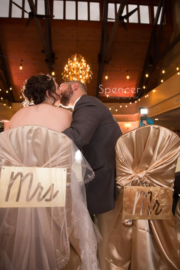 bride and groom kissing at wedding reception at shady hollow country club