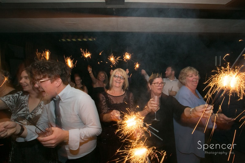 wedding guests during sparkler exit at portage country club