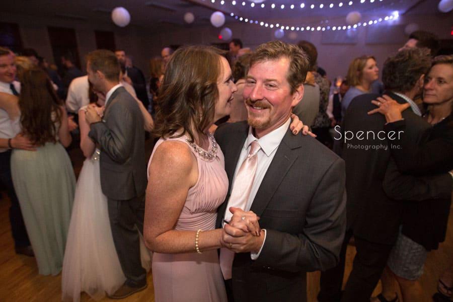 brides parents dancing at reception