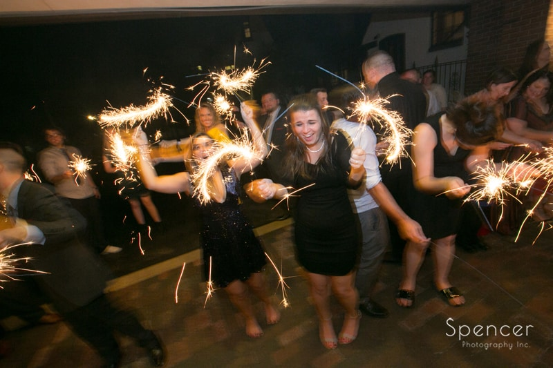 guest having fun with sparklers at akron wedding reception