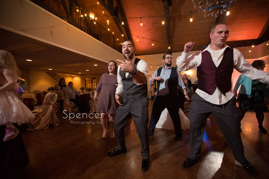 groom dancing at his wedding reception at shady hollow country club