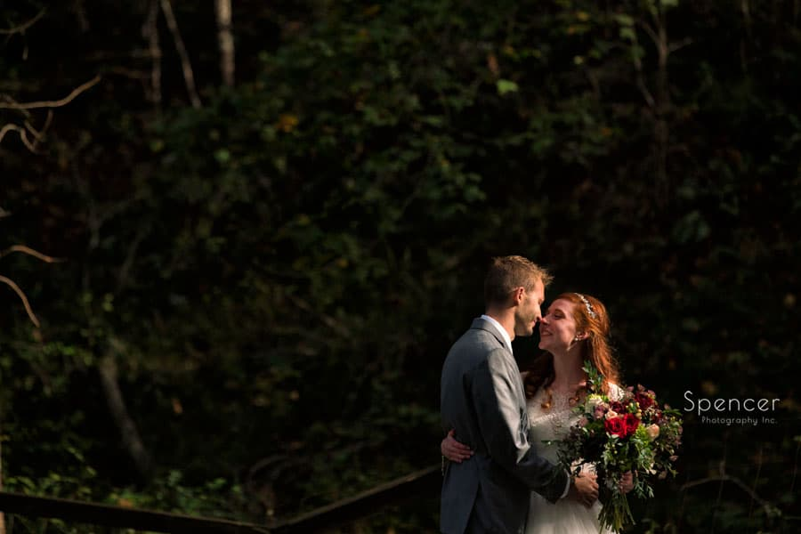 bride and groom in woods on wedding day