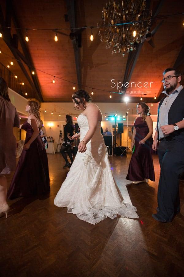 bride dancing at wedding reception at shady hollow country club
