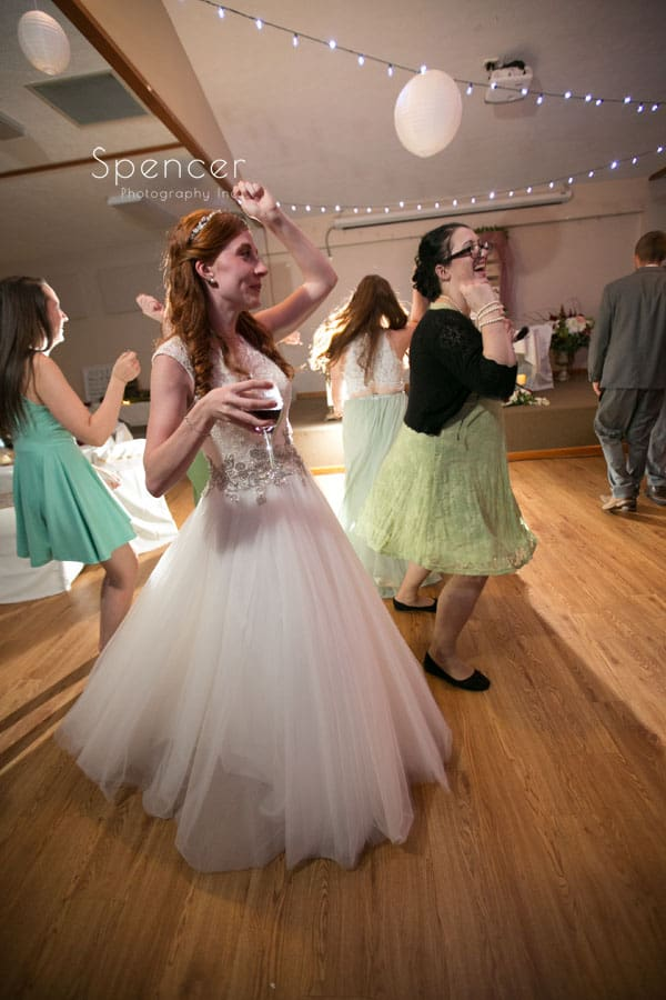 fun picture of bride dancing
