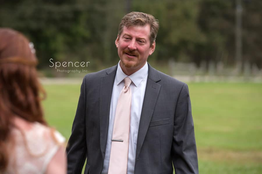 dad approaching bride on wedding day