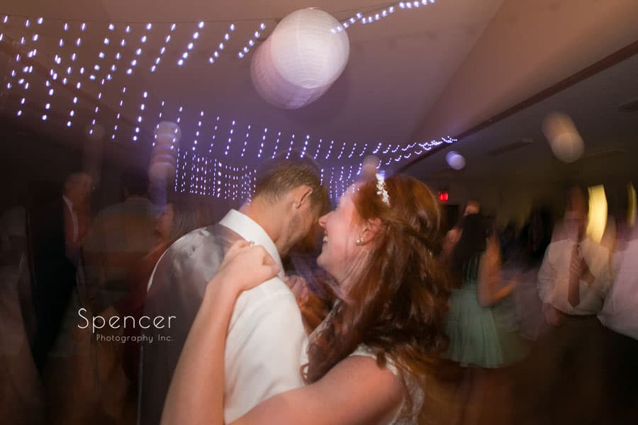 abstract picture of bride dancing with groom