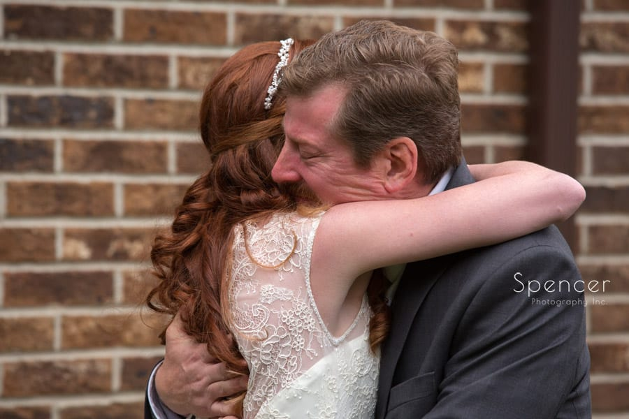 dad hugging bride
