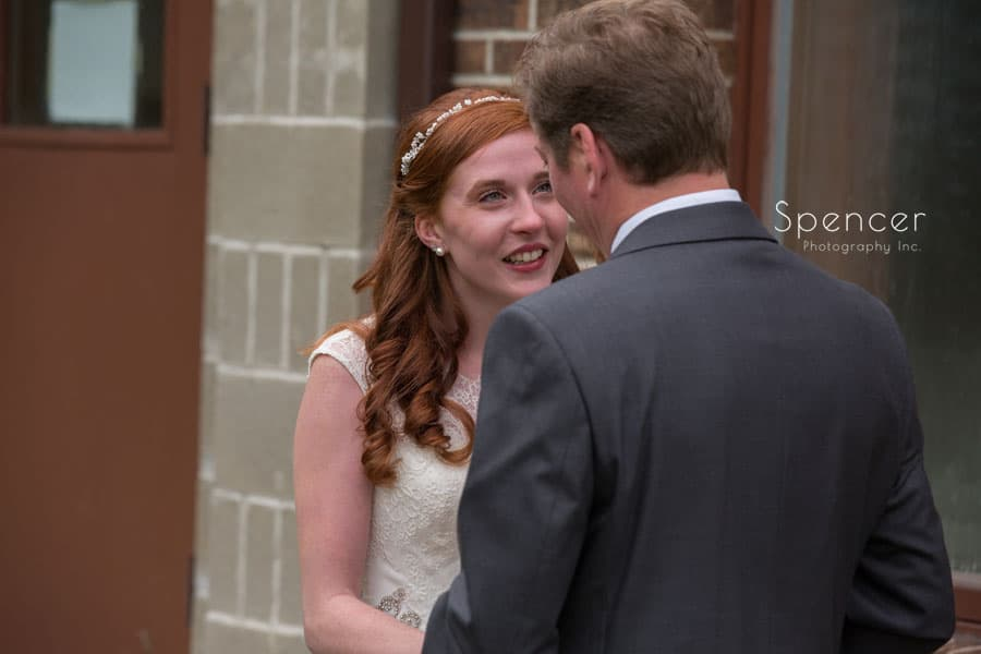 bride speaking with father