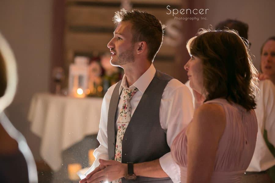 groom with brides mom at wedding reception