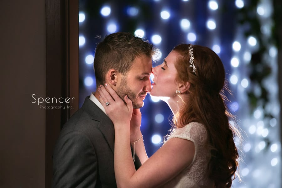 bride kissing groom after reception