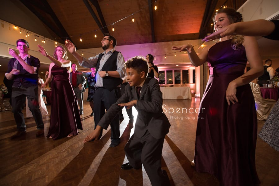 ring bearer dancing at wedding reception at shady hollow country club