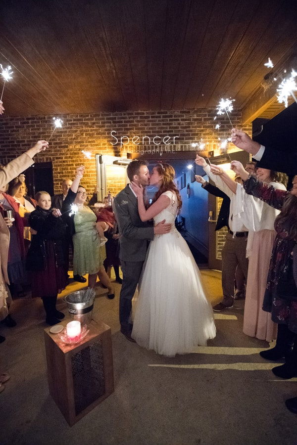 bride and groom kiss after sparkler exit