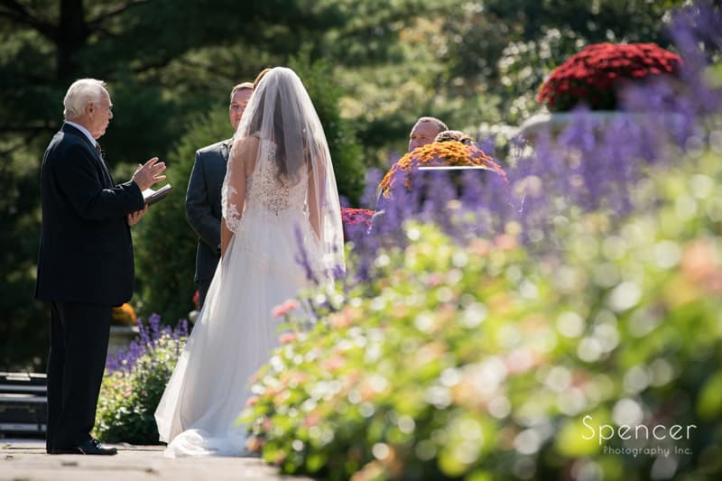 picture with flowers at stan hywet wedding ceremony