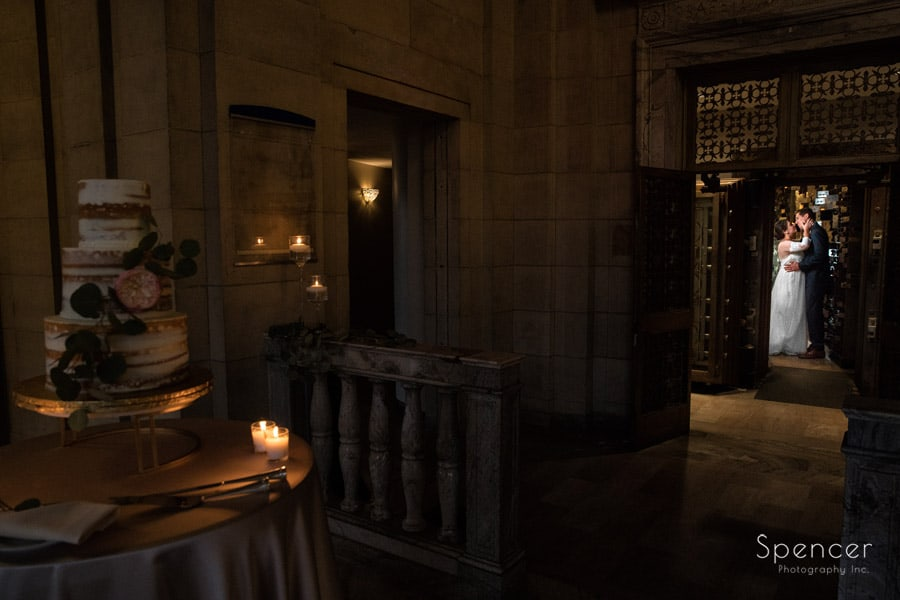 bride and groom kissing in vault at ariel pearl cleveland
