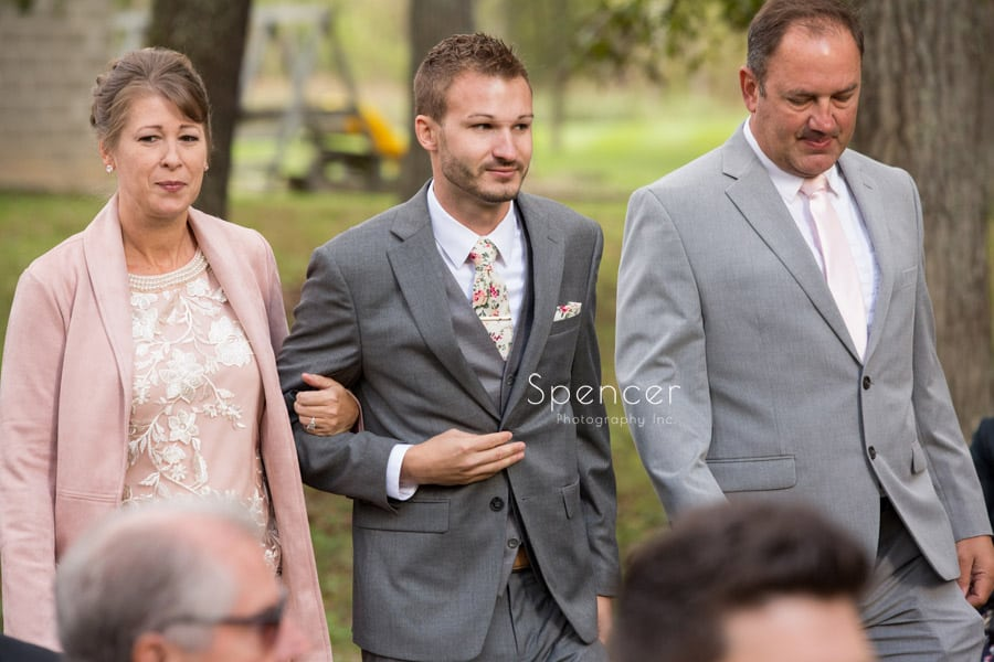 mother of groom walking down aisle