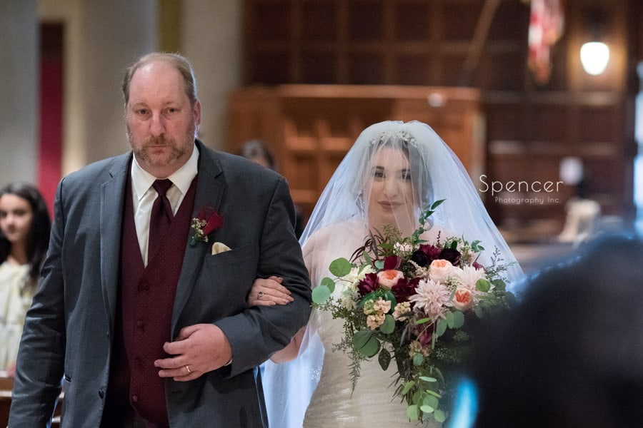 bride walking down aisle at St. Joseph Church